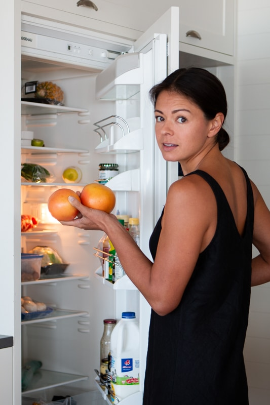 kim looking in fridge