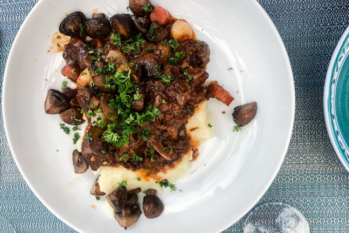 French dinner party menu cover image of beef bourguignon