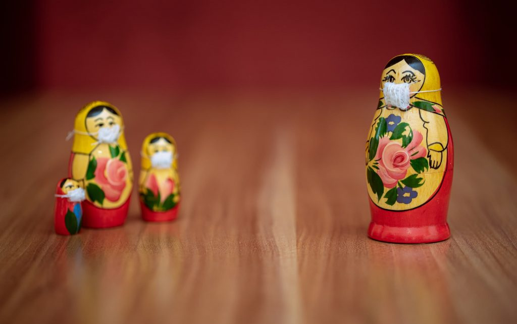 Socially distanced russian dolls wearing masks