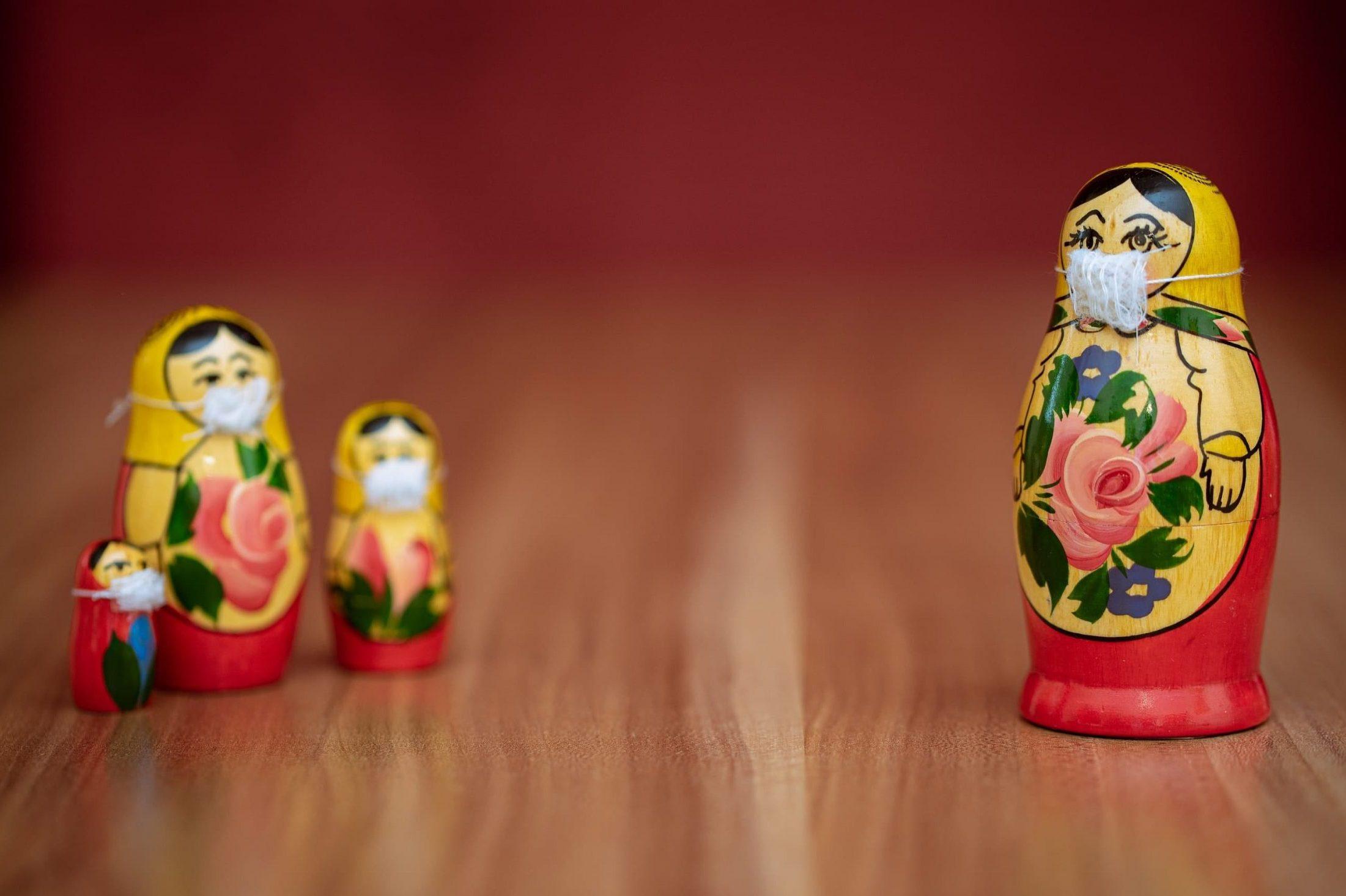 Socially distanced russian dolls wearing masks